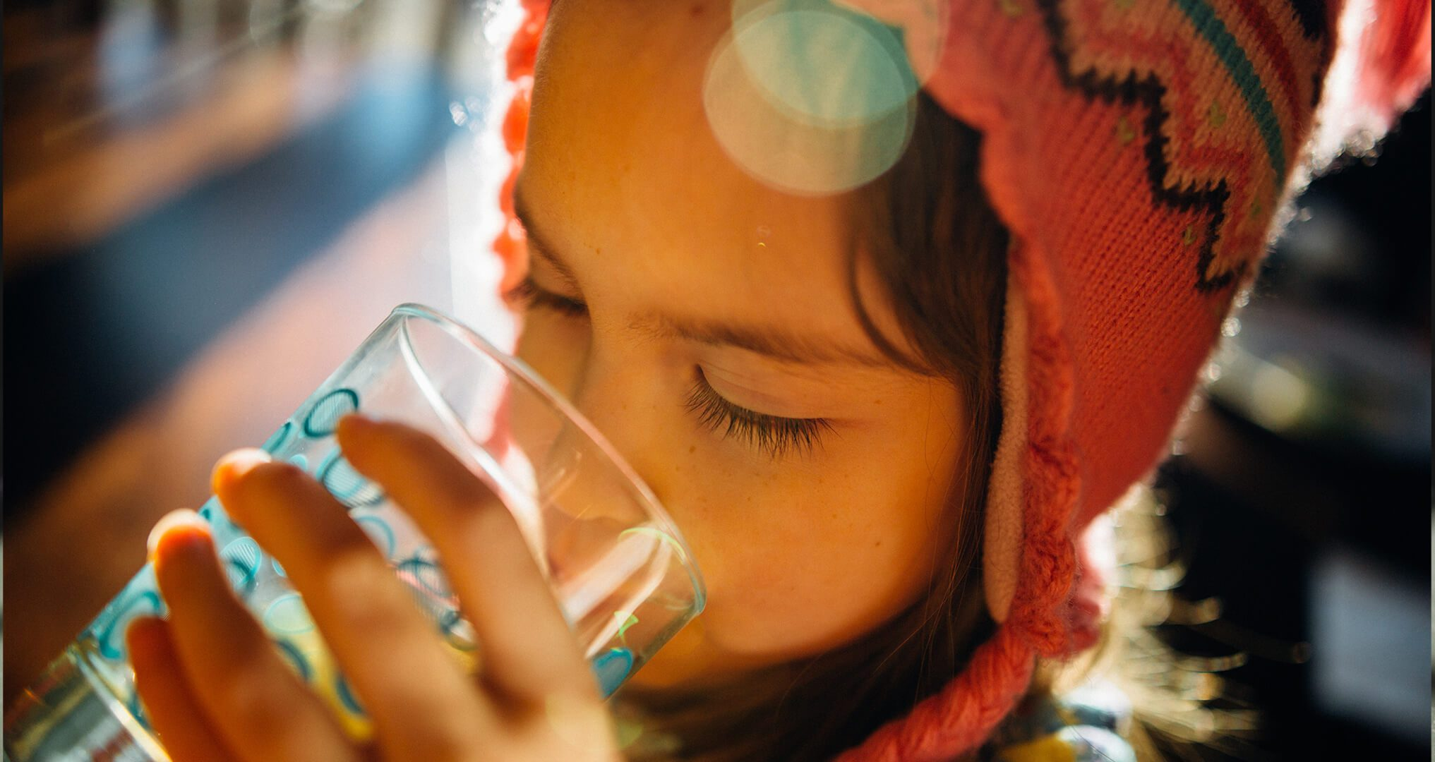 Child drinking Optimum Water