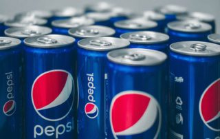 cans of pepsi soda close together