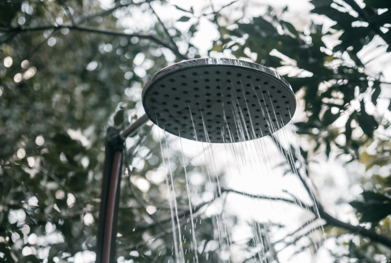 shower head pouring water outside on a gloomy day