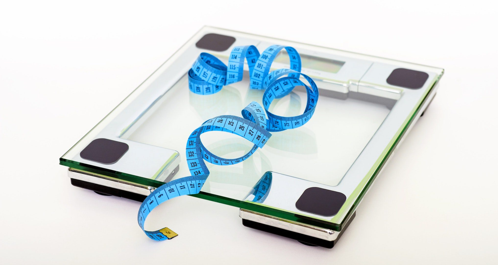bathroom scale and blue measuring tape