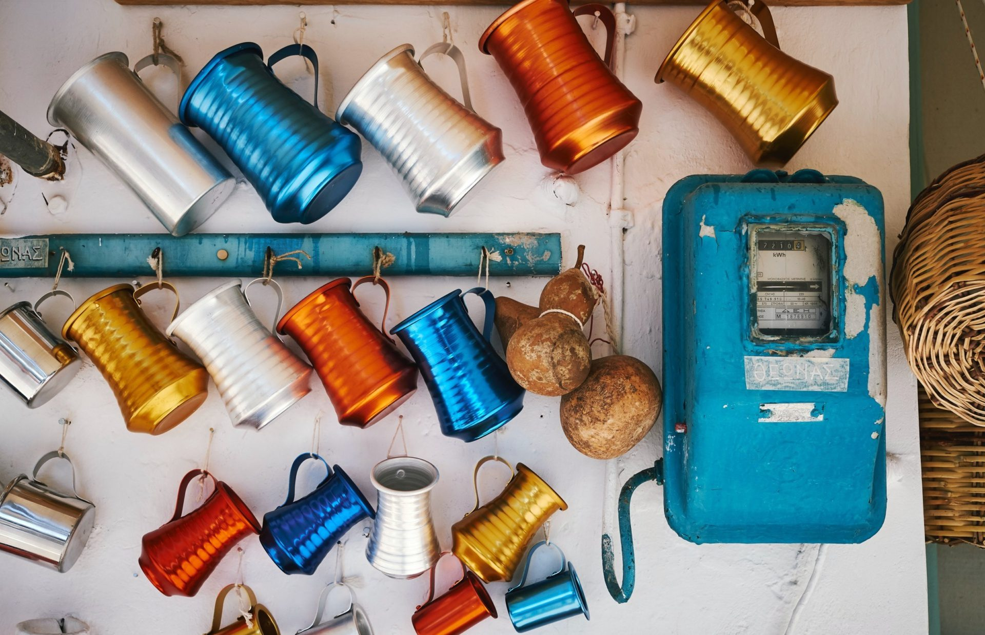 copper mugs of different colors laid down on a table